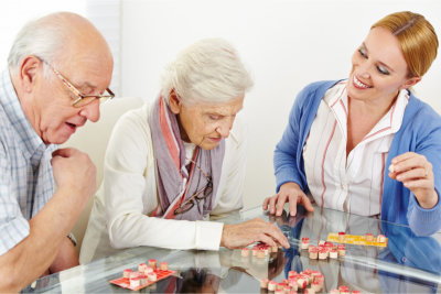 The woman is playing with the elders